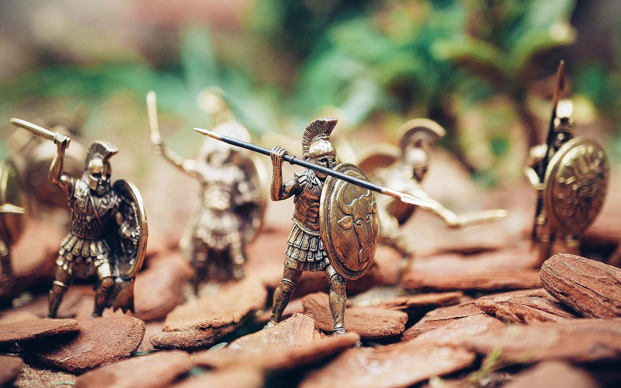 Toy roman soldiers marching forward.